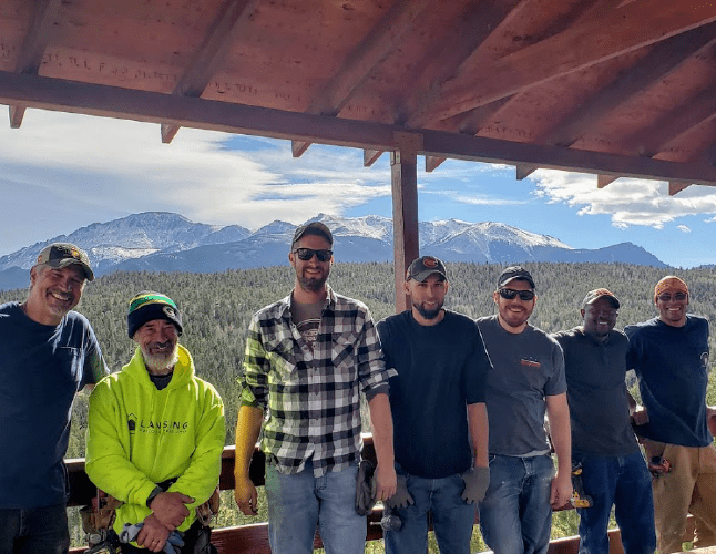 Best Buy Gutter Team photo on a sunny day with pikes peak in the background
