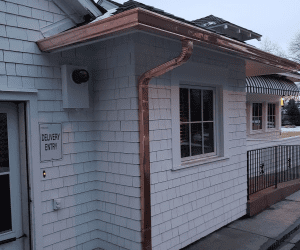 Best Buy Gutter copper gutter system installation on country club in Colorado Springs area